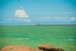 Leinwanddruck Bild - RECIFE, PERNAMBUCO, BRAZIL: Lighthouse on the horizon. Beautiful landscape with views of the rocks and turquoise sea.