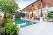 Leinwanddruck Bild - home or house Exterior design showing tropical pool villa with greenery garden,