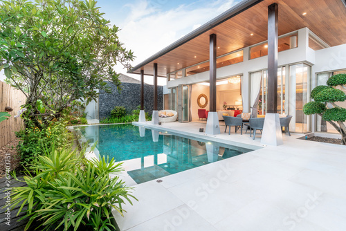 Fotografiet home or house Exterior design showing tropical pool villa with greenery garden,