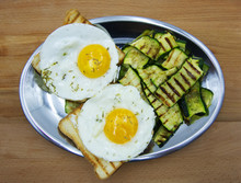 Two Fried Eggs With Grilled Zucchini And Toasted Bread