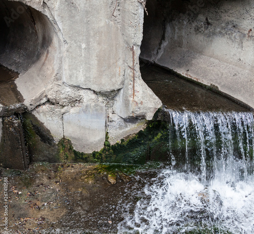 Fototapeta Run-off pipes discharging water