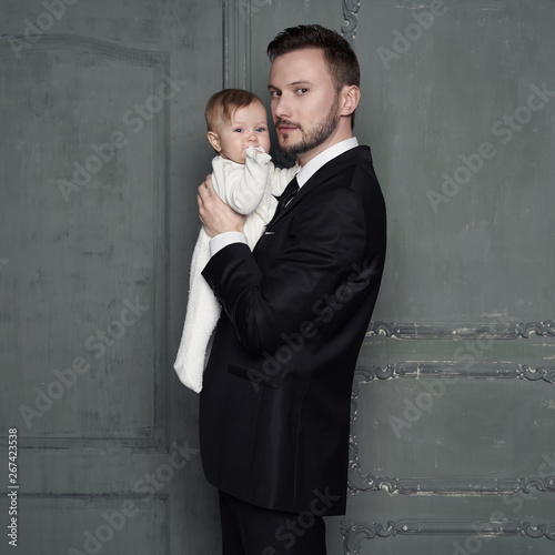 Fotobehang womenART Young father with beautiful little baby in his arms.