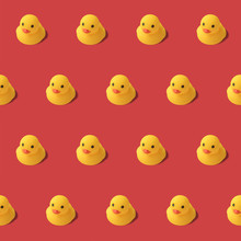 Repeatable Pattern Of Yellow Rubber Duck On Red Background Modern Style. Creative Photography.