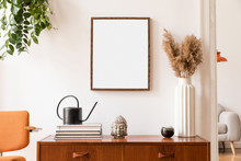 Stylish Room Of Home Interior With Brown Mock Up Frame With Vintage Accessories, Plant, Buddha,  Orange Chair And Flowers In Vase. Cozy Home Decor. Minimalistic Concept. Retro Composition Of Cupboard.