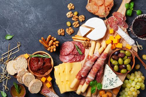 Italian appetizers or antipasto set with gourmet food on kitchen table top view Tapéta, Fotótapéta