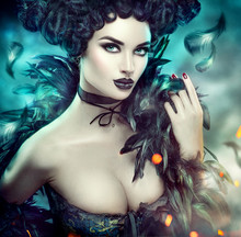 Gothic Sexy Young Woman Portrait. Halloween. Beautiful Model Girl With Fantasy Makeup In Goth Costume With Black Feathers