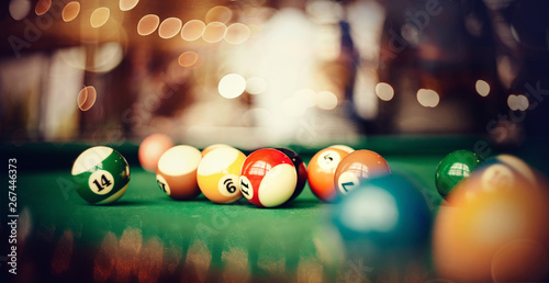Foto Colorful billiard balls on a billiard table.