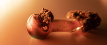 Glass Smoking Pipe With Marijuana Close-up. Smoking Culture Consept