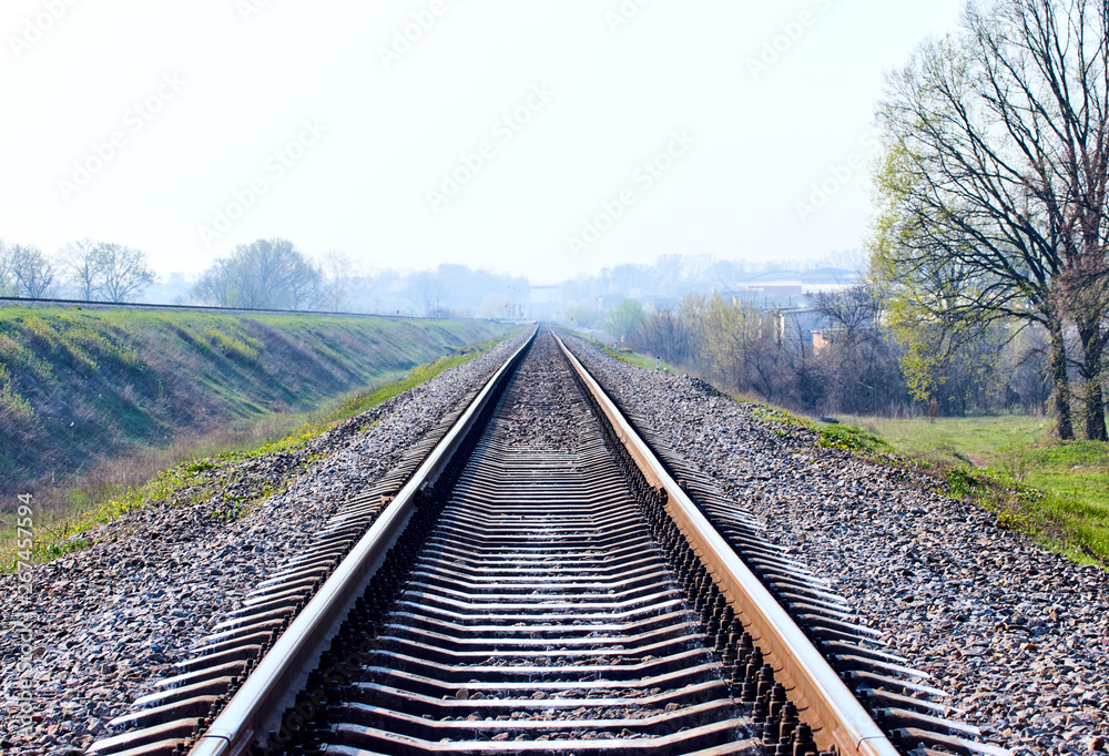 Fototapety, obrazy: railway tracks on the outskirts of the city in the early morning
