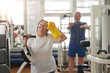 Happy elderly woman after gym work out. Diet and physical trainings for senior women. Healthy fitness exercises.