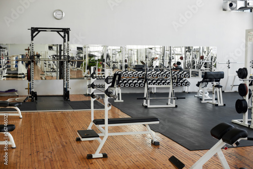 Poster Fitness Gym interior with equipment. Modern fitness center with training equipment. Commercial gym interior design.