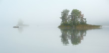 Small Island On The Lake In Mist
