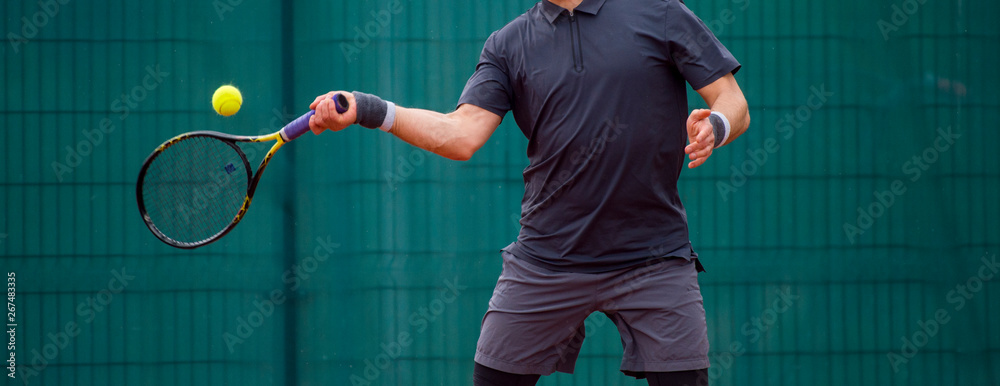Fototapety, obrazy: Male tennis player in action on the court