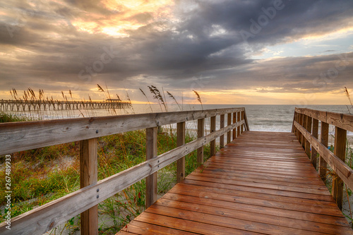 Boardwalk Leading to the Beach at Sunrise Wallpaper Mural