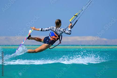 Obrazy dla dzieci  obraz-na-plotnie-kite-surfing-girl-in-sexy-swimsuit-with-kite-in-sky-on-board-in-blue-sea-riding-waves-with-water-splash-recreational-activity-water-sports-action-hobby-and-fun-in-summer-time-kiteboarding-sport