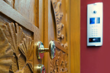 Wooden Door With Modern Intercom