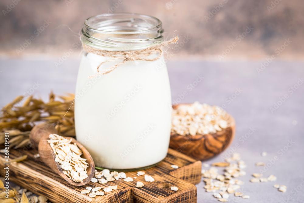 Fototapety, obrazy: Vegan oat milk, non dairy alternative milk.
