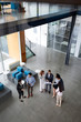 Leinwandbild Motiv Business people working together in office hall.