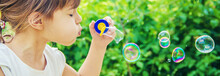 The Children Are Blowing Bubbles. Selective Focus.