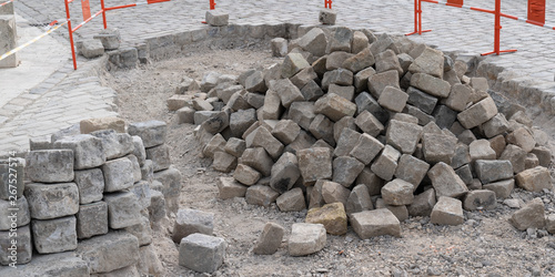Photo pile of processed pieces of granite prepared for work on paving cobblestones str