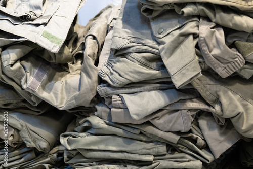 Fotografija camouflage clothing green sampling of camouflage jackets in a store