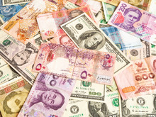 Background From Paper Money Of The Different Countries. Global Currency