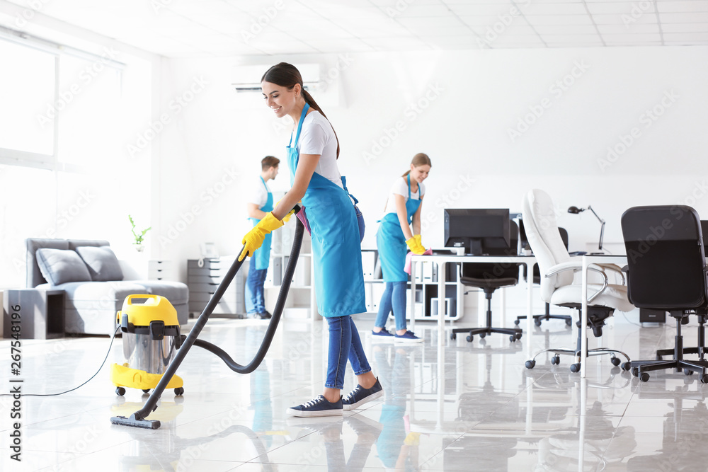 Fototapeta Team of janitors cleaning office