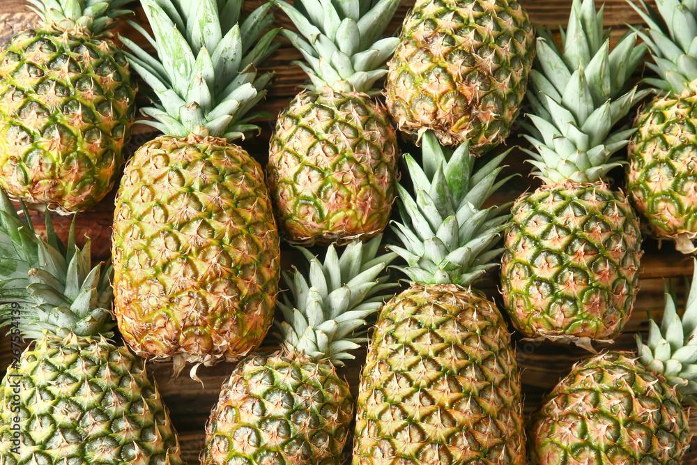 Fototapeta Many ripe pineapples as background