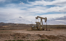 Nodding Donkey Oil And Gas Pump At Montezuma Creek Utah