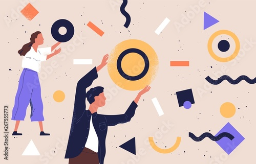 Obraz Pair of people collecting and organizing abstract geometric shapes scattered around them. Man and woman holding circles. Concept of teamwork. Vector illustration in contemporary flat cartoon style. - fototapety do salonu