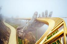 Danang , Vietnam. View In Fog Of The Golden Bridge On Ba Na Hills In Da Nang On Rainy Day