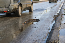 Big Pothole On Road After Winter