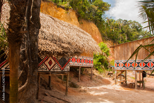 Large house covered with sape grass, Indigenous tribe village near Manaus, Amazo Canvas Print