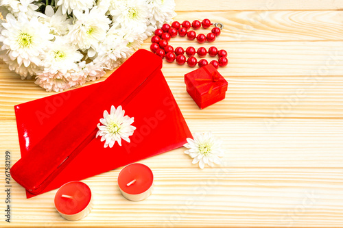 Romantic gift concept. Valentines day or 8th march or love holiday. Letter, case and flowers. Table setting on wooden background