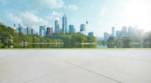 Empty Floor With Park And Modern Cityscape . Morning Scene .
