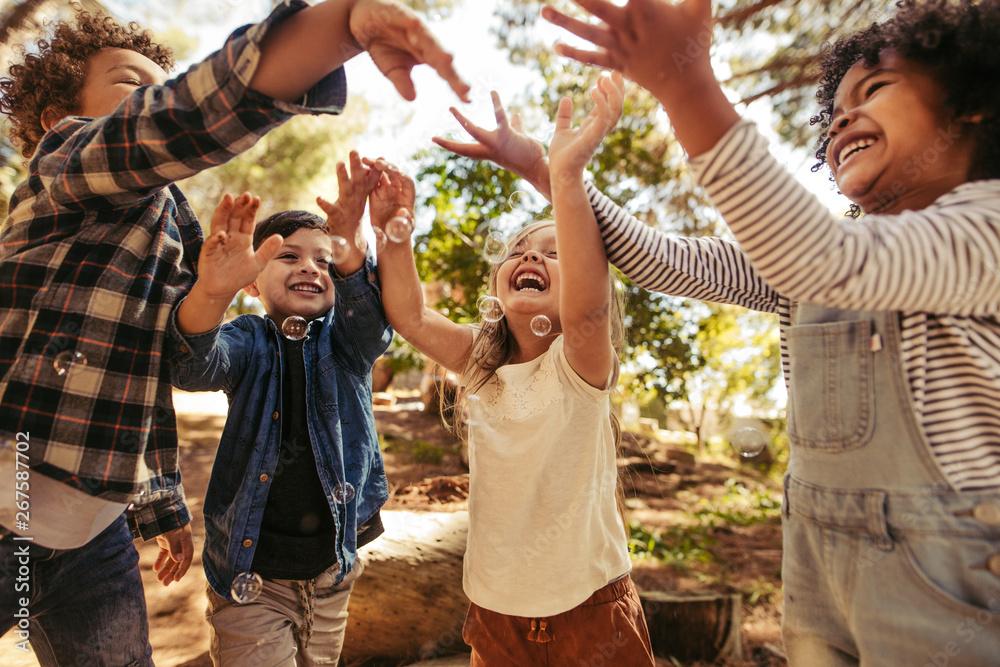Fototapeta Kids having fun together