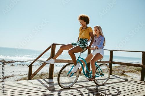 Foto Girls having a great fun on bike