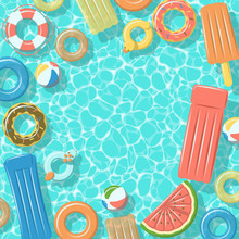 Swimming Pool From Top View With Colorful Inflatable Rubber Rings, Rafts, Beach Ball And Life Buoy