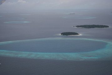 Fototapeta na wymiar Small islands in the Indian ocean from the plane