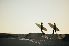 Friends Going On Surfing In The Ocean