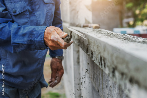 closeup hand of worker are plastering
