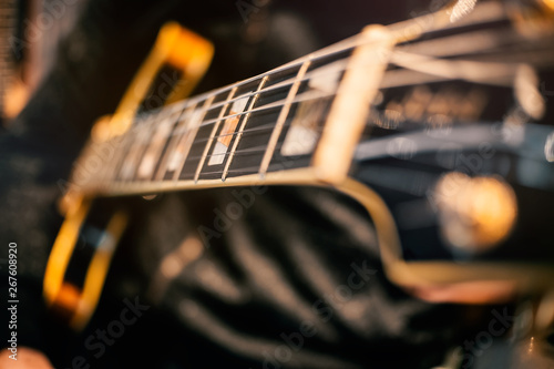 guitar and music string macro detail focus zone studio recording play hand concert closeup art guitarust rock electric color contrast melody harmony rhythm magic creation craft wood composer chord  - 267608920