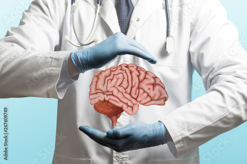 Obraz na plátně Image of a doctor in a white coat and brain above his hands