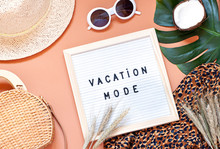 Vacation Mode Text On The Felt Board With Concept Fashion Outfit. Flat Lay. Top View