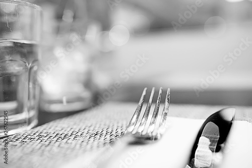 Foto auf AluDibond Restaurant serving in the restaurant, fork and knife / interior view of the restaurant with a table served knife and fork on the table in a cafe