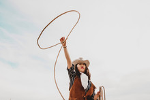 Pretty Chinese Cowgirl Throwing The Lasso In A Horse Paddock