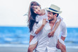 Happy Romantic Couples lover holding hands together walking on the beach
