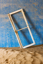 Window Frame And Drifting Sand In An Abandoned Diamond Mining Town