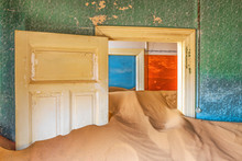 Doorways And Drifting Sand In An Abandoned Diamond Mining Town