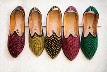 Colorful Shoes Hanging On Rack